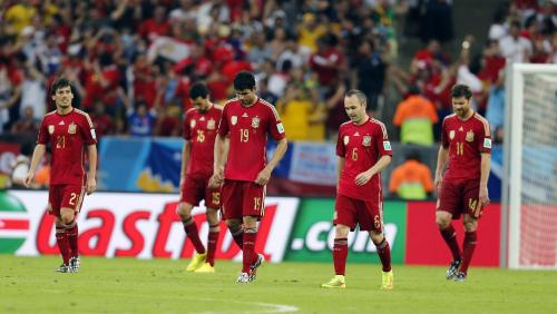 Sensing their demise after the second Chile goal, Spanish players reform to kickoff positions. Pic from Yahoo News. I don't own the rights to this photo, and I'm not making any money on it.